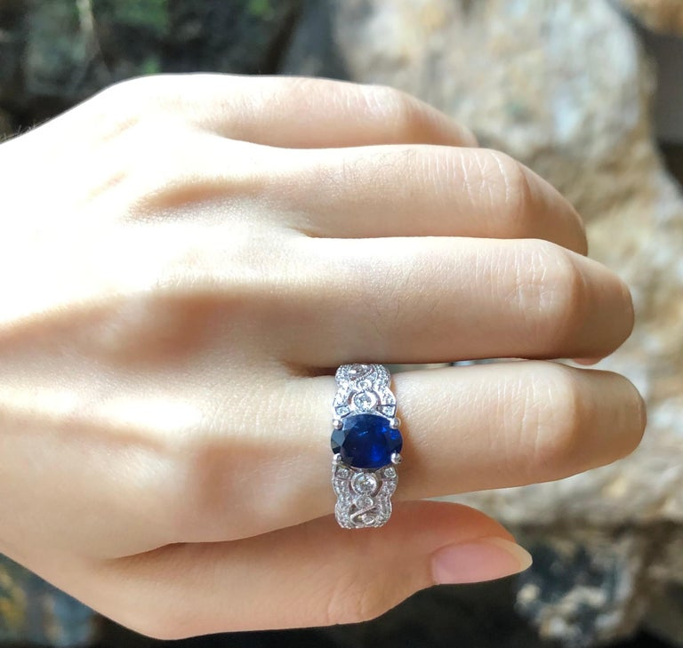 Oval Cut Blue Sapphire with Diamond Ring Set in 18 Karat White Gold Settings For Sale