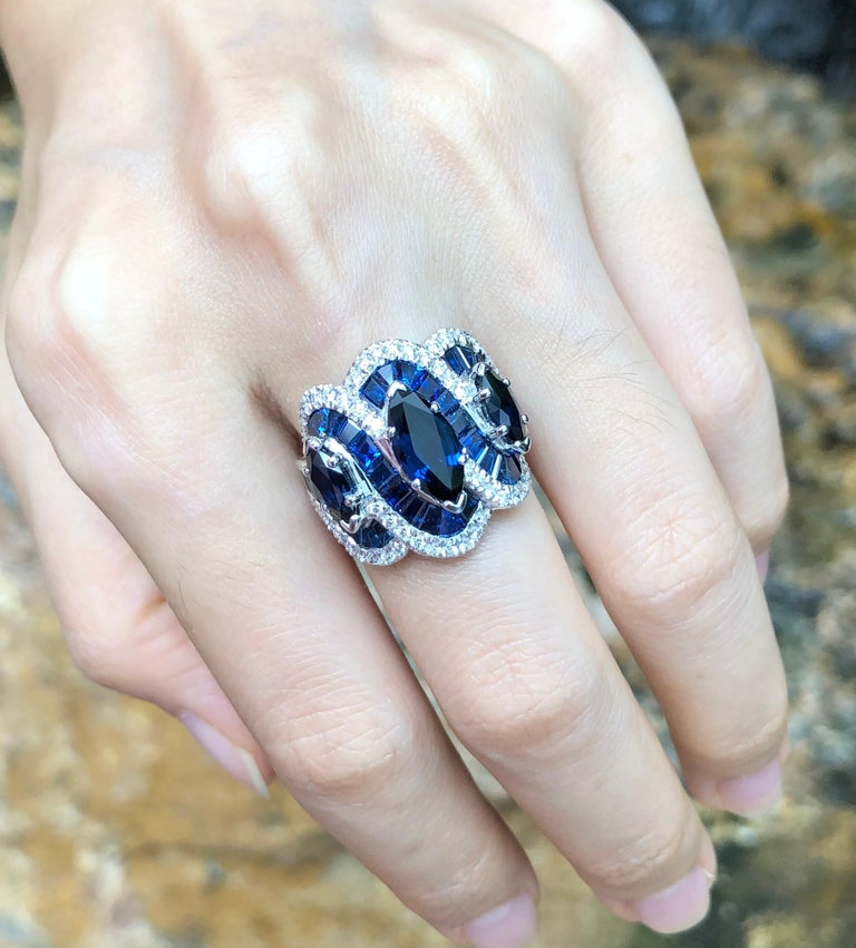Women's Blue Sapphire with Diamond Ring Set in 18 Karat White Gold Settings For Sale