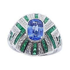 Blue Sapphire with Emerald and Diamond Ring Set in 18 Karat White Gold Settings