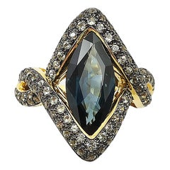 Blue Sapphire with Green Sapphire Ring Set in 18 Karat Gold Settings