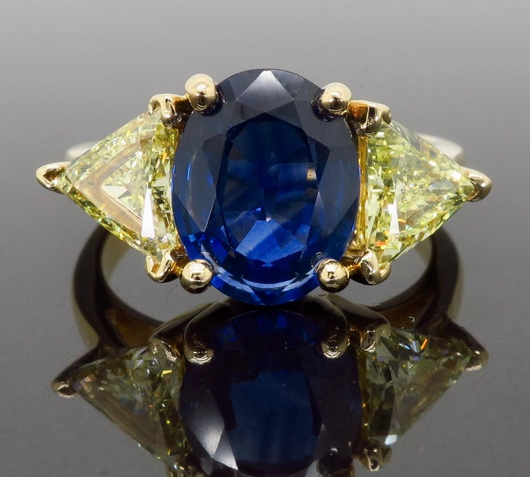 Oval Cut Blue Sapphire and Yellow Diamond Three-Stone Ring For Sale