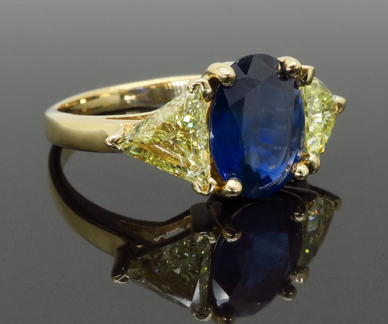 Blue Sapphire and Yellow Diamond Three-Stone Ring For Sale 3