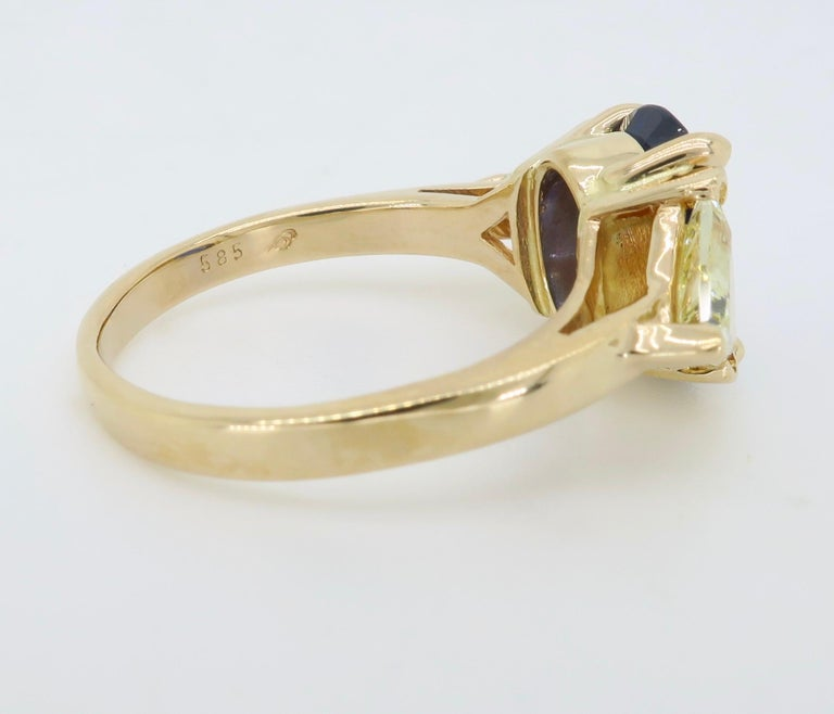 Blue Sapphire and Yellow Diamond Three-Stone Ring For Sale 4