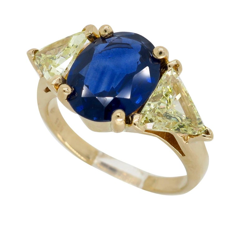 Blue Sapphire and Yellow Diamond Three-Stone Ring For Sale 5