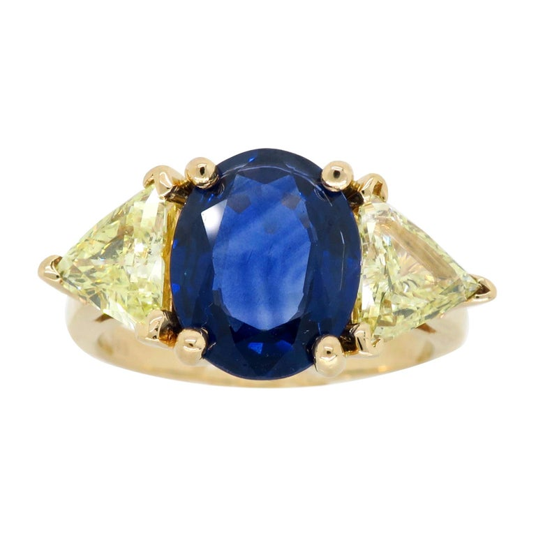 Blue Sapphire and Yellow Diamond Three-Stone Ring For Sale