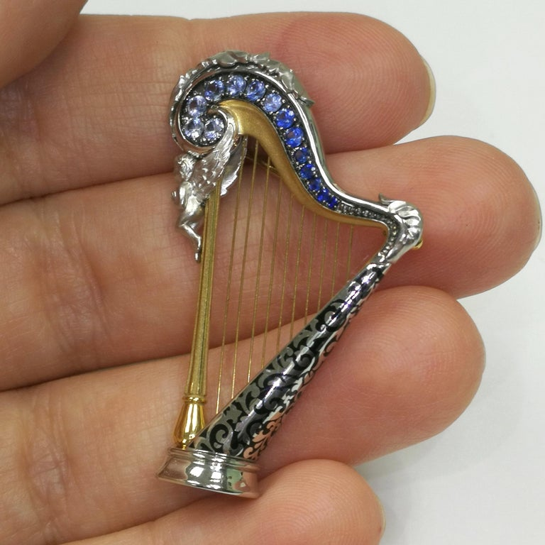Contemporary Blue Sapphires 18 Karat White Gold Harp Brooch For Sale