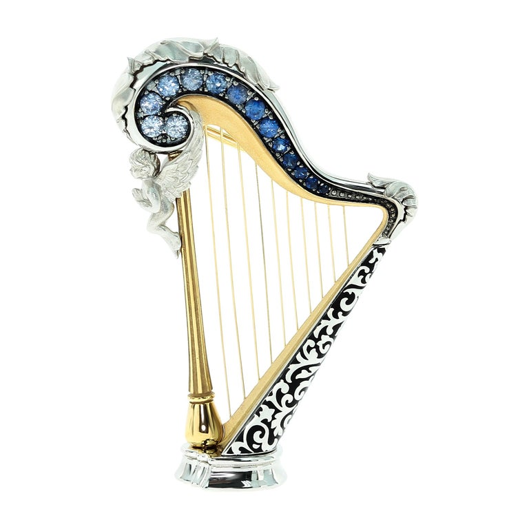 Blue Sapphires 18 Karat White Gold Harp Brooch For Sale