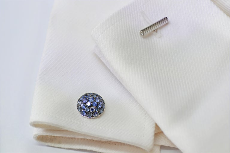 Handcrafted in Margherita Burgener  family workshop, located in Valenza - Italy The cufflinks are bombé, like an half ball, fully pavé set in  blue sapphires.   The pavé part is blackened to highlight the blue of the sapphires.    A beautiful