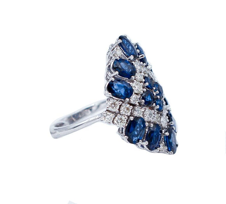 Beautiful ring in 14 karat white gold structure mounted with blue sapphires and diamonds. This ring was totally handmade by Italian master goldsmiths and it is in perfect conditions. Diamonds 1.49 ct Blue Sapphires 5.76 ct Total Weight 9.70 gr RF