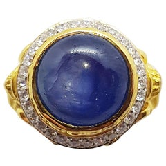 Blue Star Sapphire with Diamond Ring Set in 18 Karat Gold Settings