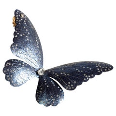 Blue Titanium Butterfly Half-Earring Set with Diamonds and a Kite Solitaire