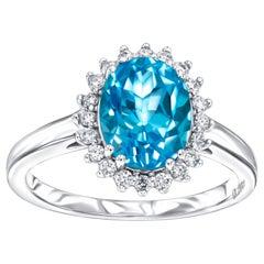 Blue Topaz 2.20 Carat Oval 0.20 Carat Round Diamond White Gold Halo Ring