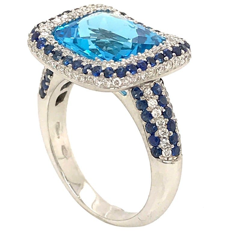 Blue Topaz and Blue Sapphire with Diamonds on White Gold 18 Karat Cocktail Ring For Sale