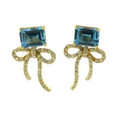 Blue Topaz and Diamond Bow Tie Ribbon 18 Karat Yellow Gold Earrings