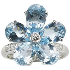 Blue Topaz and Diamond Flower Ring