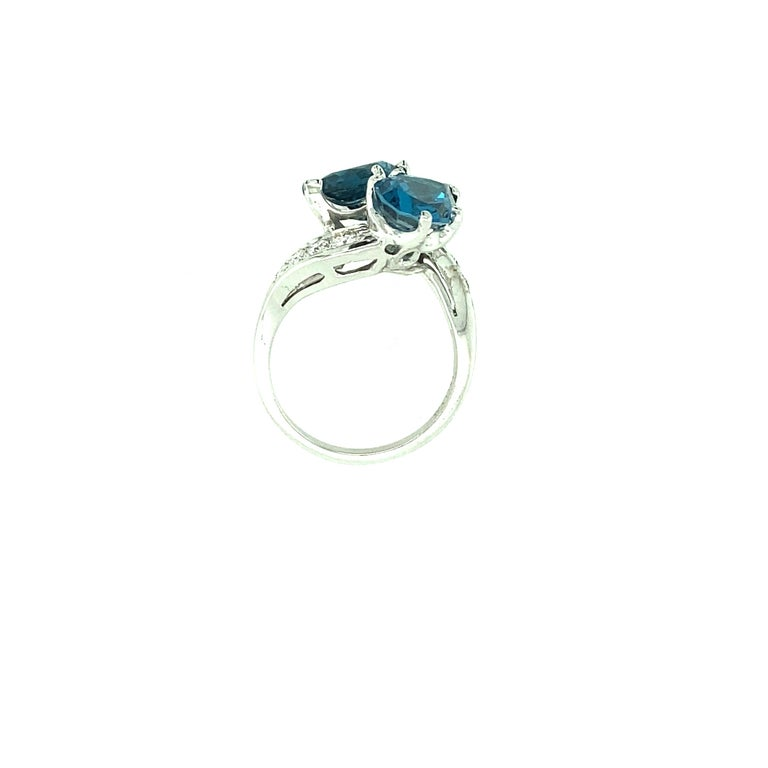 Contemporary Blue Topaz and Diamond Ring For Sale