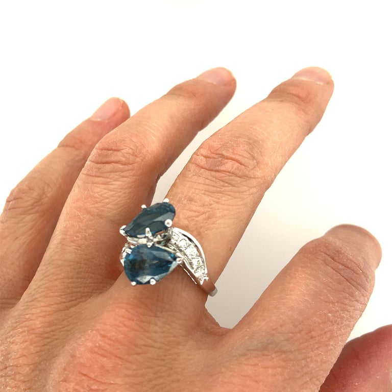 Pear Cut Blue Topaz and Diamond Ring For Sale