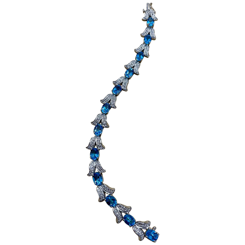 Blue Topaz and Diamond Affordable Tennis Bracelet 14 Karat White Gold, 7 Inch