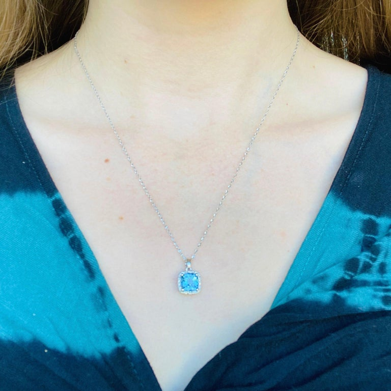 14k White Gold Swiss Blue Topaz-2.85 carats White Diamond-.15 carat Stone Width and Height: 9.23 millimeters Chain Length at Longest: 18in Chain Length at Shortest: 14in Chain Width: 1.03mm Weight: 2.02 grams Gemstone Weight- 1.75 carats