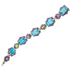 Blue Topaz, Peridot and Amethyst Bracelet with Pink Sapphires