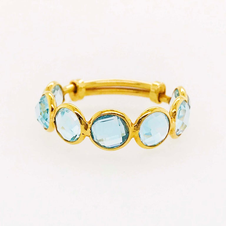 This unique, fun blue topaz ring is creative and innovative! With an adjustable band design this ring can fit almost any finger for different looks and jewelry pairing designs! The adjustable ring has genuine, nature blue topaz gemstones that have