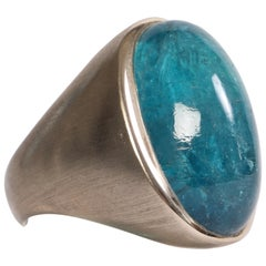 18 K White Brushed Gold Ring With A Blue Tourmaline Cabochon by Marion Jeantet