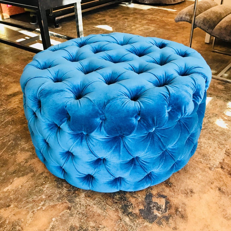 Custom blue tufted velvet round ottoman. This ottoman can be made to any size with COM.