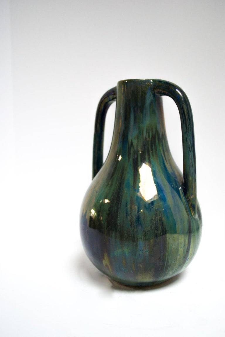 Alphonse Cytere took the world by storm in 1903 when he opened his studio in Rambervillers, France. It was here near the artistic center of Nancy that Cytere began creating ceramics with unique metallic, iridescent glazes. This beautifully crafted