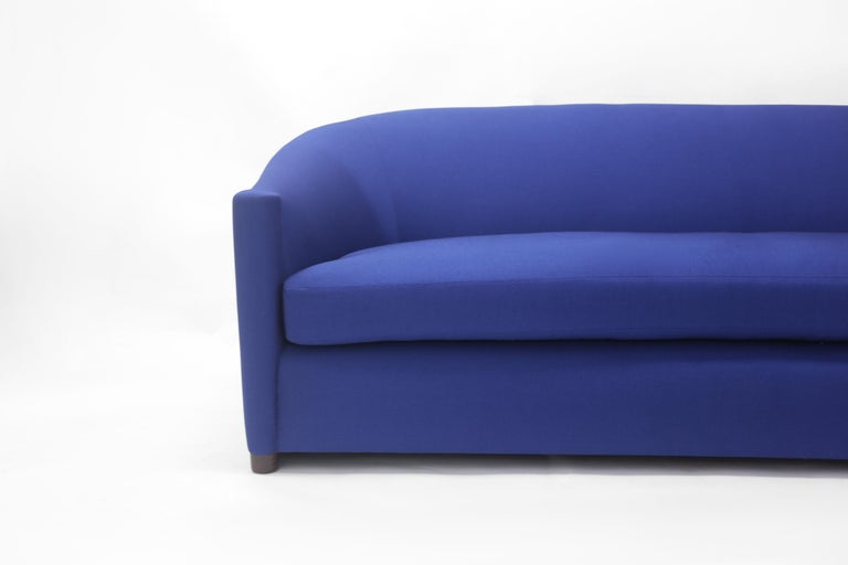 Blue Upholstered Curved Sofa with Wood Base and Loose Seat Cushion on Wood Base 3
