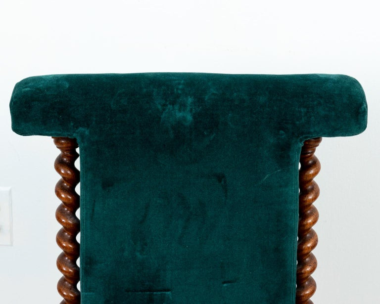 Blue velvet upholstered slipper chair with rectangular shaped seat back and barley twist side rails on castors. Please note of wear consistent with age including finish loss to the velvet and minor chips to the wood.