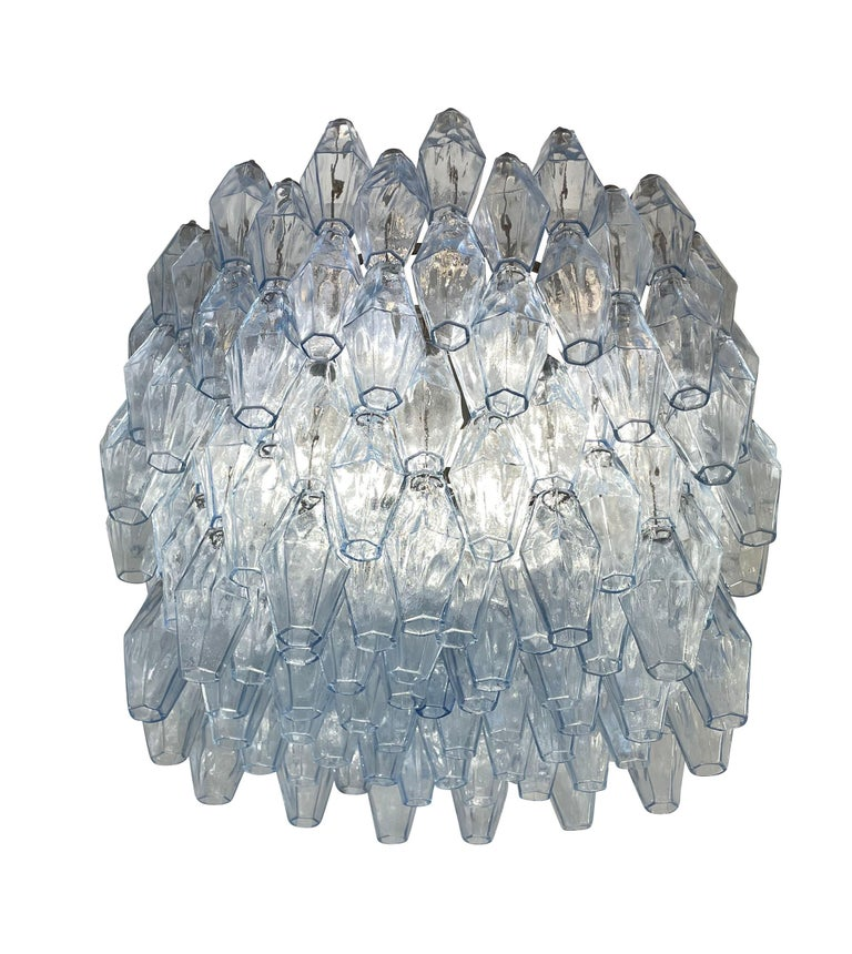 Mid-century chandelier by Venini (marked) made with their iconic poliedri Murano glasses. The glasses are blue and mounted on a metallic frame holding nine E26 sockets. Ready to hang on a chain.  Condition:  Excellent vintage condition, minor