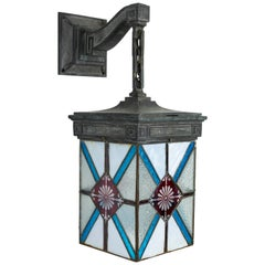 Blue, White and Deep Red Stained Glass and Bronze Lantern Sconce