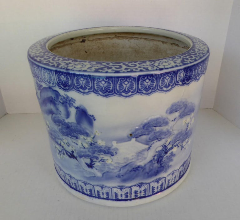 1950s Japanese Modern earthenware ceramic Hibachi with hand painted mountainous village scene with plum blooms and pine trees. The symbol of the plum or peach tree, which are the first to bloom in the New Year, is of perseverance, hope and the