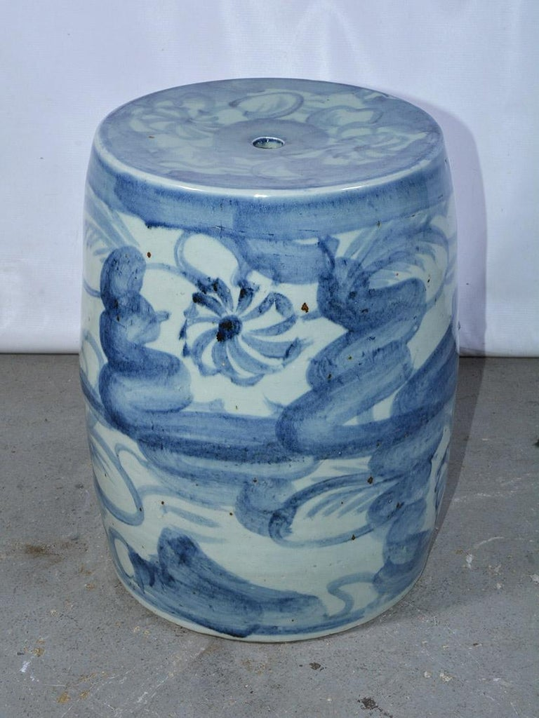 Chinese blue and white porcelain drum shape garden stool in floral motif. The ceramic stool can be used as plant Stand, side table or extra seating. Wonderful in a garden room, porch, or the most elegant living room.