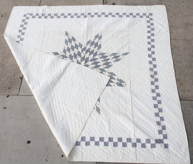 Blue and white eight point star from Pennsylvania. Made from blue and white check fabric. Fine piecework and nice quilting.