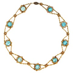 Blue Zircon and gold links Chocker Necklace in 14 Karat Gold, circa 1920
