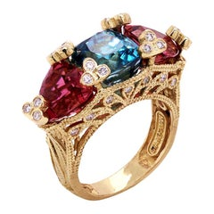 Blue Zircon and Rubellite Tourmaline Three-Stone Ring with Gold and Diamonds