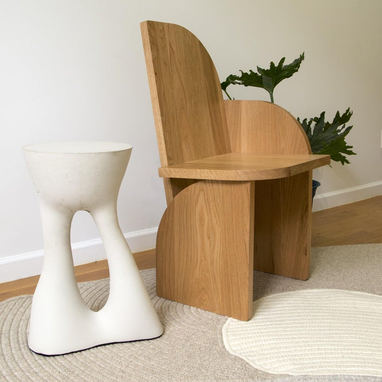 This piece is a floor model that was used at a trade show for a few days. It's in great condition with very minimal wear.  This listing includes 1 Bluff Side Chair in Oak designed by Luft Tanaka for Souda. The 'Right' version has an arm-rest for