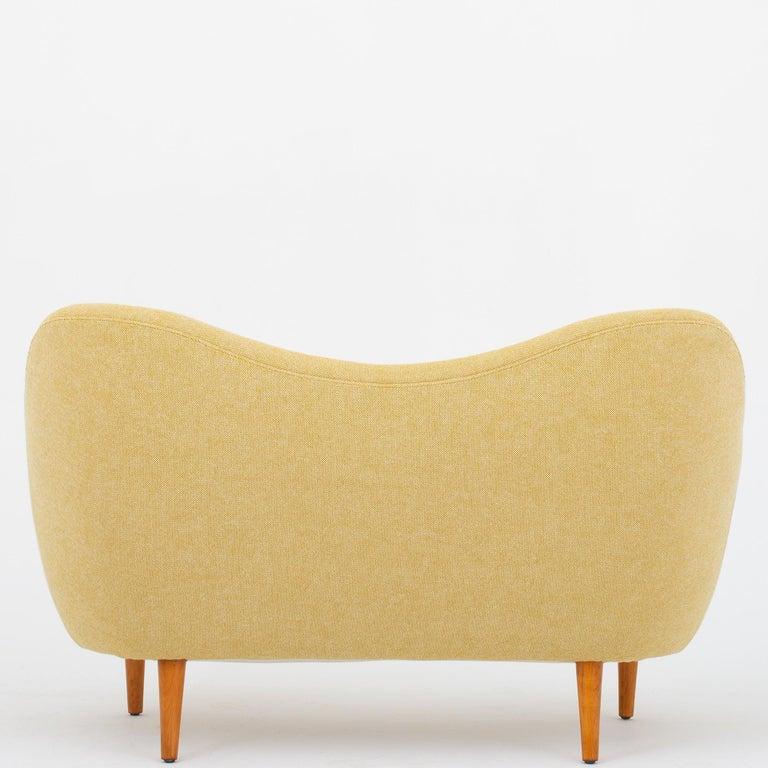 BO 46 - Reupholstered 2-seat sofa in Hallingdal col. 407 & 457, legs in lacquered beech. Designed in 1946. Maker Bovirke.