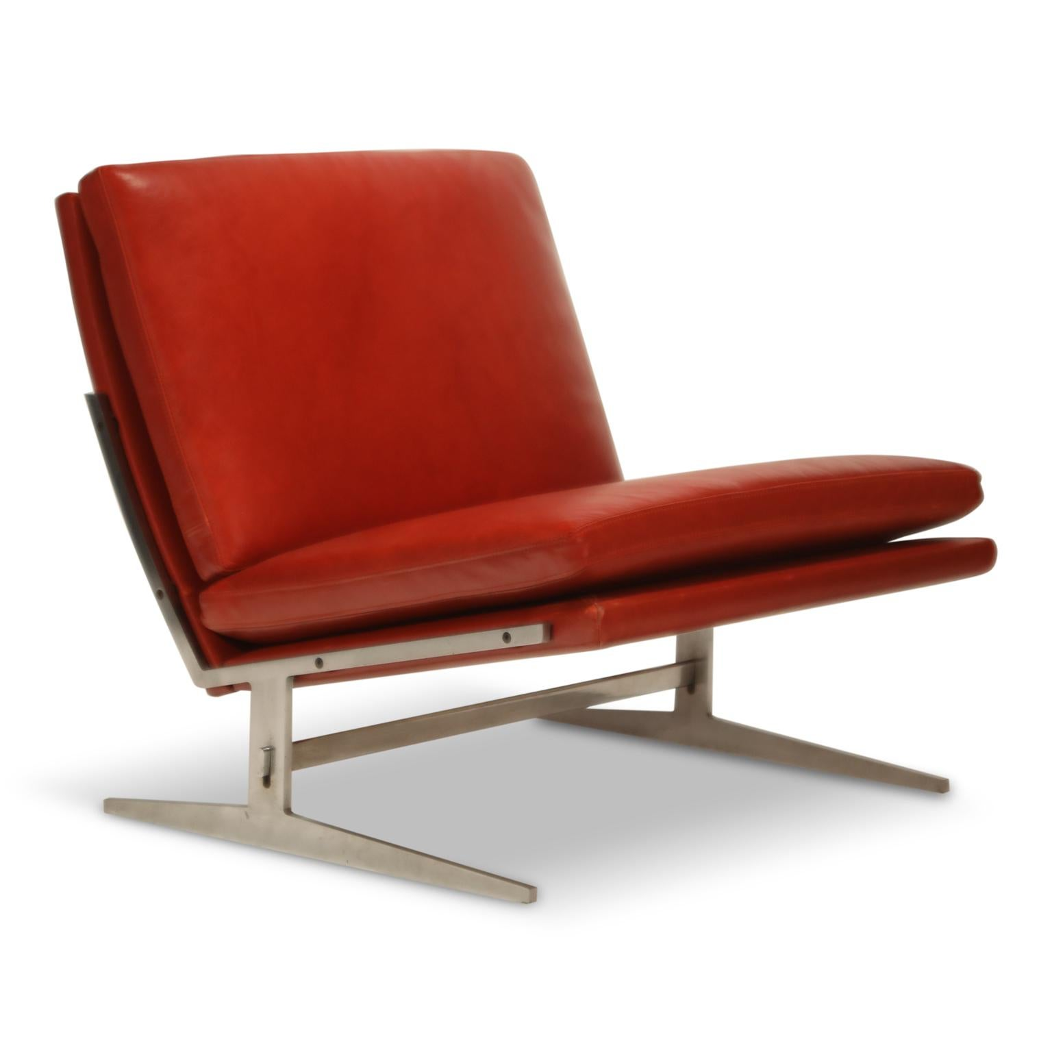 A red leather lounge chair designed by Jørgen Kastholm and Preben Fabricius in 1962 for Danish maker Bo-Ex, offered by Automaton