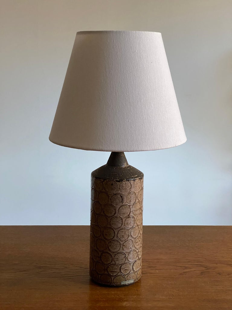 A table lamp produced by Svensk form, designed by Bo Bergström. In hand painted and ornamented stoneware. Bears label.  Lampshade attached for illustration and is not included in purchase. Dimensions stated are without lampshade.  Other