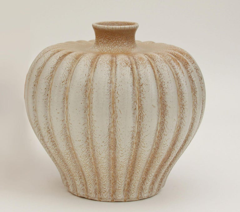 Of pumpkin shape, fluted body, white glaze marked TOPAS/Made in Sweden, Bo Fajans, D 167, and E.D.