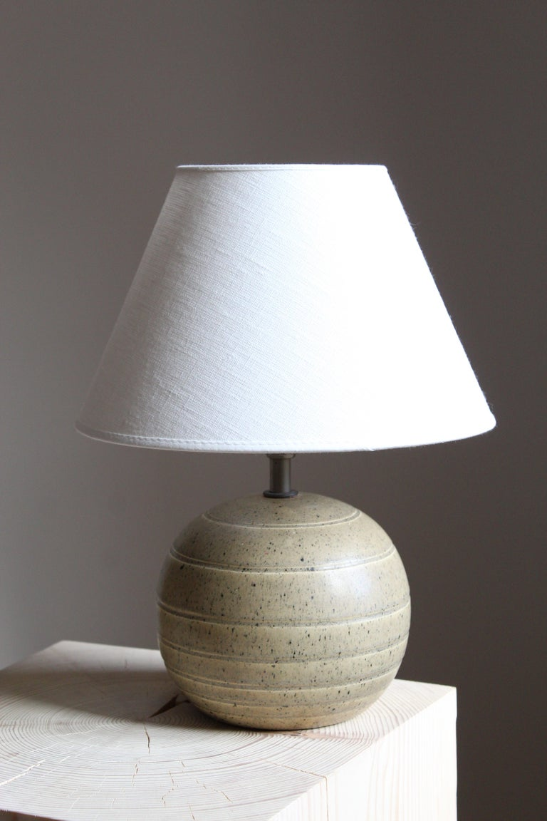 An early modernist table lamp. Bo Fajans, Sweden, 1930s. Marked and labeled.  Lampshade not included. Stated dimensions excluding lampshade. Lampshade can be included on request against a revised shipping quote.  Other designers of the period