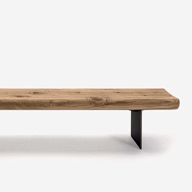 Bench board in handcrafted in solid cedar wood, treated with natural pine extracts wax. Feet in lacquered iron. Solid cedar wood include movement,  cracks and changes in wood conditions,  this is the essential characteristic of natural  solid cedar