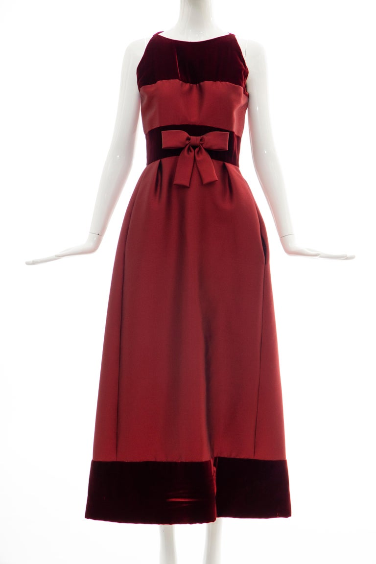 Bob Bugnand, Circa: 1960's cranberry silk gazar and silk velvet sleeveless evening dress, empire waist with silk gazar bow, two front pockets, back zip with hook and eye closure.  No Size Label:  Bust: 31, Waist: 26, Hips: 45, Length: 54