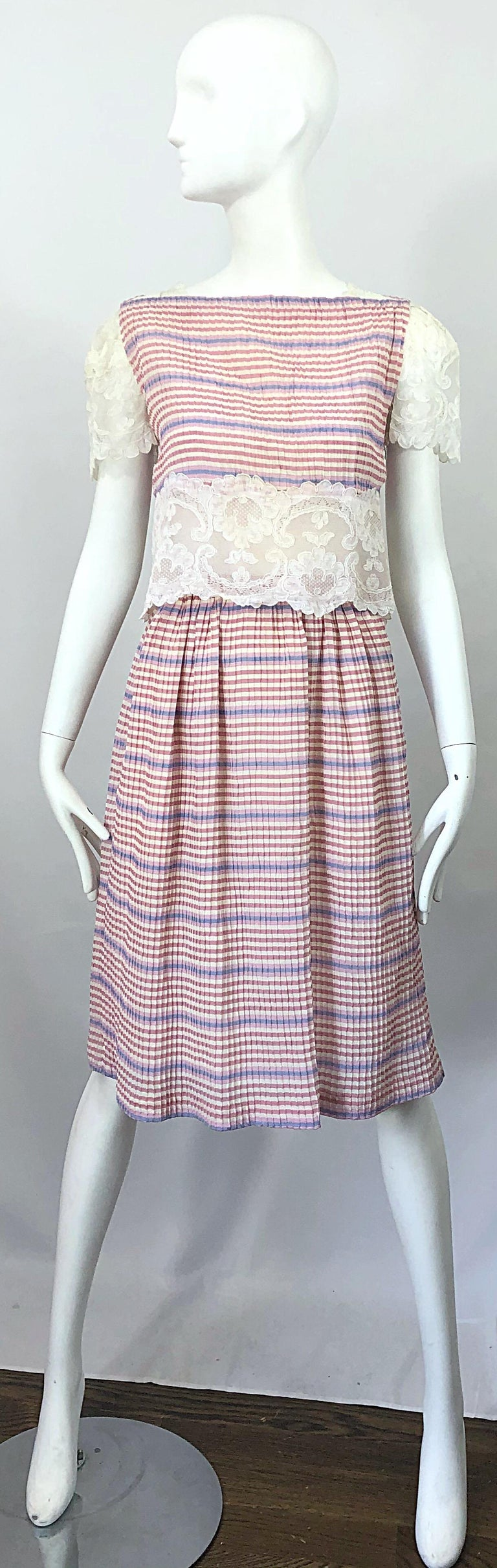Pretty vintage BOB MACKIE (late 70s) stripes silk and lace crop top and skirt ensemble! Features pleated silk with stripes printed in purple, pink and ivory. White lace cut-out at waist is lined in nude chiffon. Lace cut-outs at each shoulder as