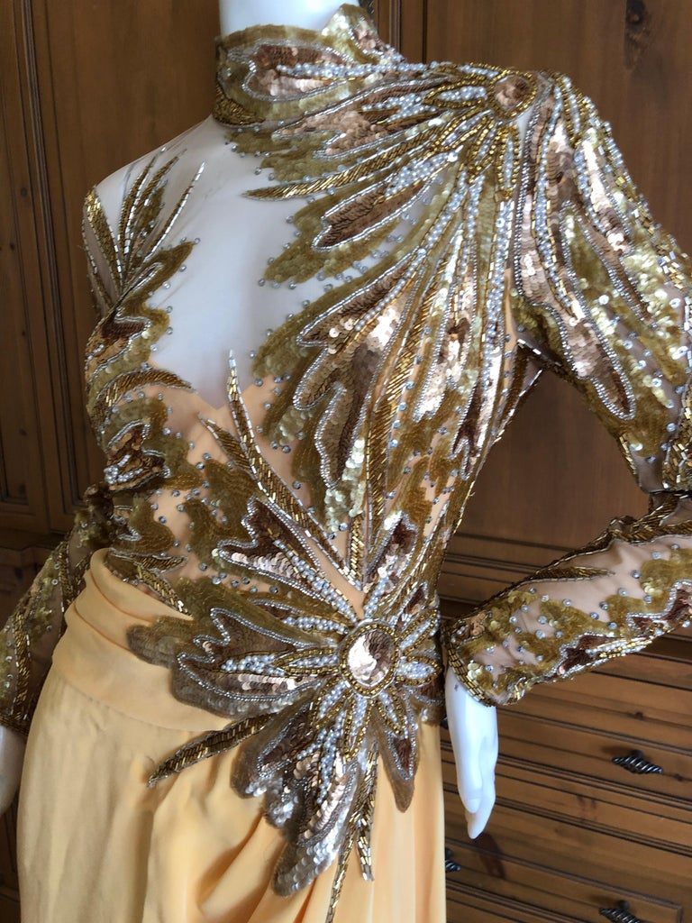 Bob Mackie  1980's Crystal Beaded Sheer Evening Dress Sheer netting embellished with thousands of glass bugle beads, this is classic Mackie at his best. So much prettier than the photos, please use zoom feature to see details. Size 8 Bust 37