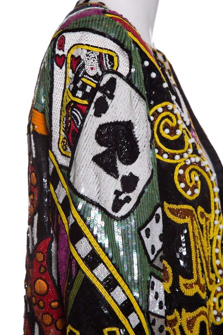 Bob Mackie multi-color bead embellished Monte Carlo jacket with casino-themed images, sequin detailing throughout dual hook closures at front. This item is in good condition with light signs of wear. Wear includes some missing beading in various