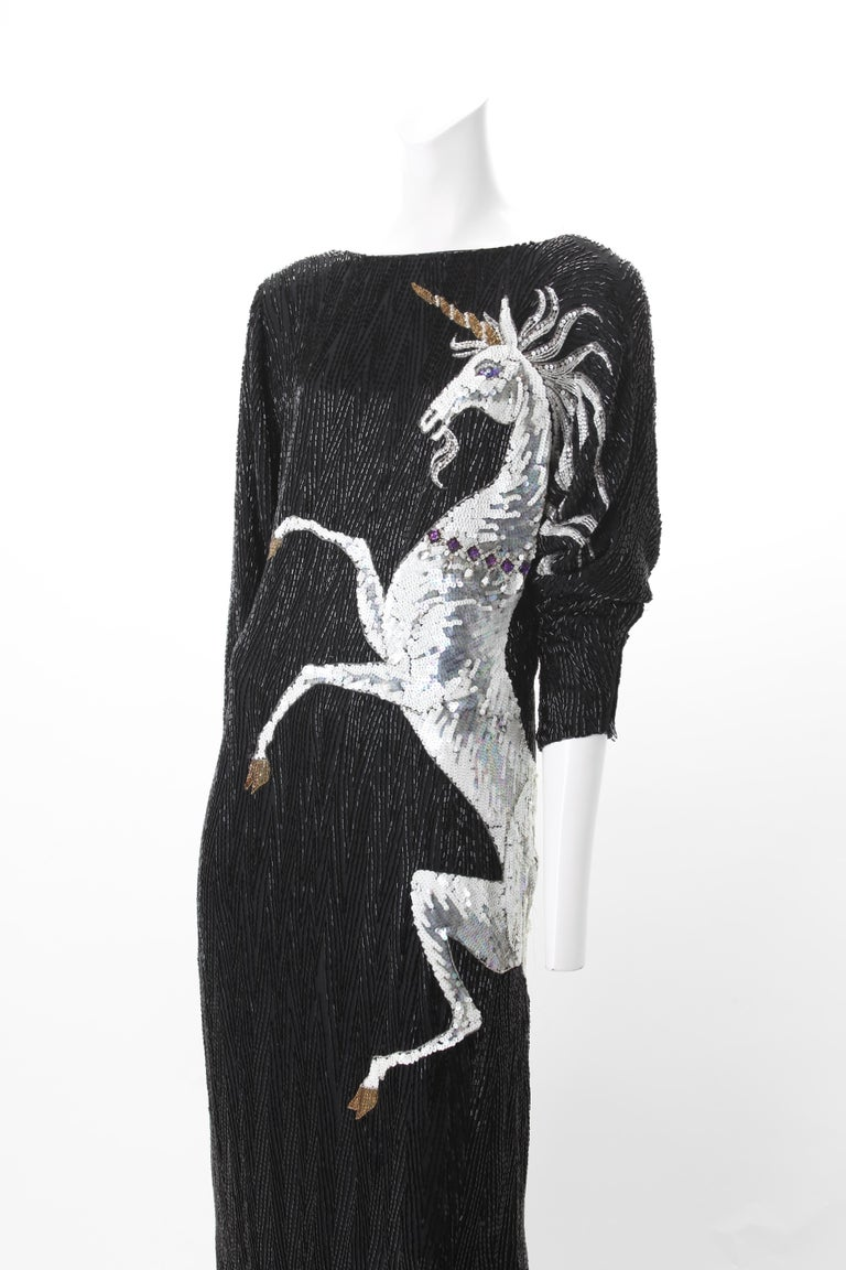 Bob Mackie Vintage Couture Black Silk Beaded Gown with Unicorn motif. c.1980s. Boat neck gown with hand-sewn black beading throughout the entire dress. Silver and white Unicorn motif aligning the dress's left bodice continuing through to the back