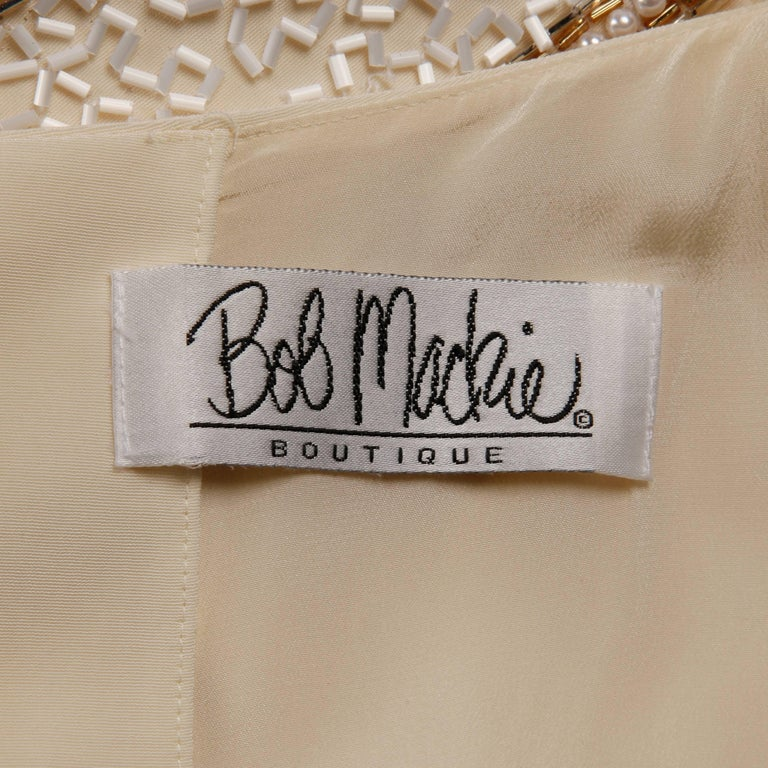 Stunning vintage Bob Mackie jumpsuit that can be worn instead of a formal dress or evening gown. Fully lined with rear zip, hook and button closure. The marked size is 8. The bust measures 38